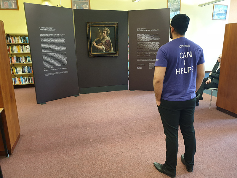man viewing Self Portrait as Catherine of Alexandria by Baroque artist Artemisia Gentileschi