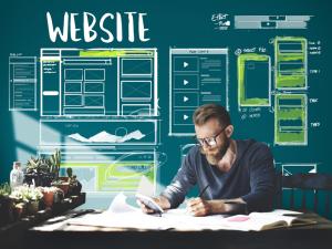 bearded man creating website wireframes