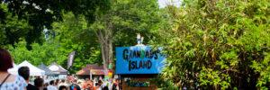 people enjoying grandad's island in a park